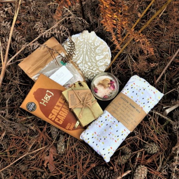 The Bath Box - Contains rose bath salts by Hart Healing Kitchen, a luxury body sponge by Doesn't Cost The Earth, a vegan rose petal soap bar by The Guilt Free Soapery, a relaxing organic eye pillow by Little Home Eco and some delicious luxury chocolate by Harris & James
