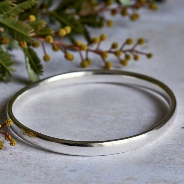 Handmade, oval shaped silver bangle