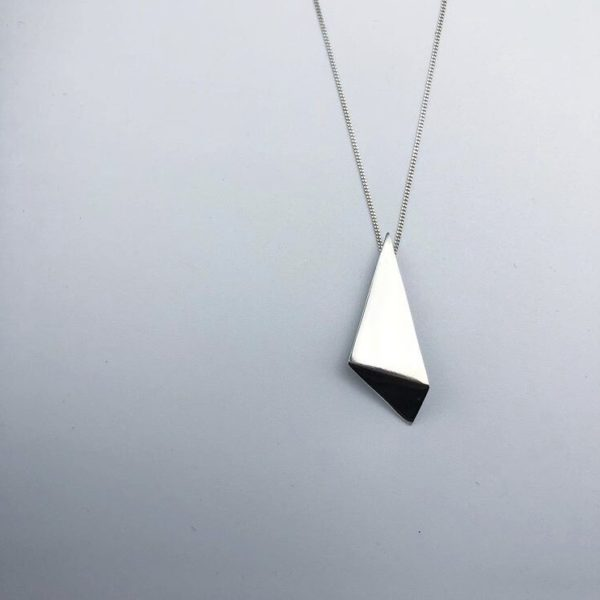 "Geometric statement pendant with a high polish finish  Handmade sterling silver  Each pendant is 35mm long and 12mm wide. Each pendant comes with a 18"" silver chain"