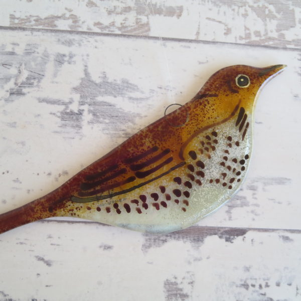 Hand painted fused glass song thrush hanging.