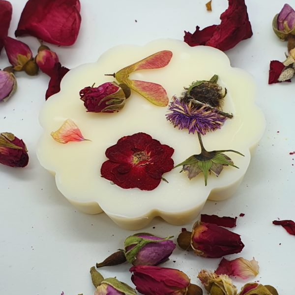 Handmade vegan soy wax melts, scented with a blend of aroma and essential oils from a choice of scents. The melts are decorated with real flowers, fruit and foliage, mostly foraged by myself and hand pressed, again by me. Melts come in 3 sizes; large fluted tart, medium solid disc and small cupcake. The hot scent throw ranges from 20 hours to 30 hours, dependent on size of melt. These are available in a range of floral, fruity, musky and herby scents. Also available are soy wax air fresheners ready to hang by a natural jute string anywhere in the home or office.  These fresheners after approx 6 months of use can be broken up and used as wax melts.
