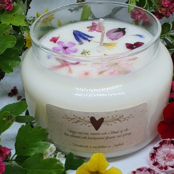 Handmade vegan soy wax large candles and small votive candles, all scented with a blend of aroma and essential oils. They are then decorated with real flowers, fruit and foliage, which have, for the main been foraged and handpressed by myself. Large Candles also have a beautiful ribbon tied around its neck. This can have a personalised label which has an ode to the recipient. The ode can be humorous, sentimental or inspirational, customers choice. Large candles have a burn time of approx 36-40 hours and votives a burn time of 20 hours all candles have a choice of floral, fruity, musky or herby scents.