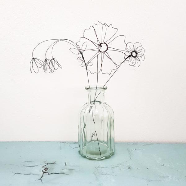 Summer wire flowers flowers in a glass bottle