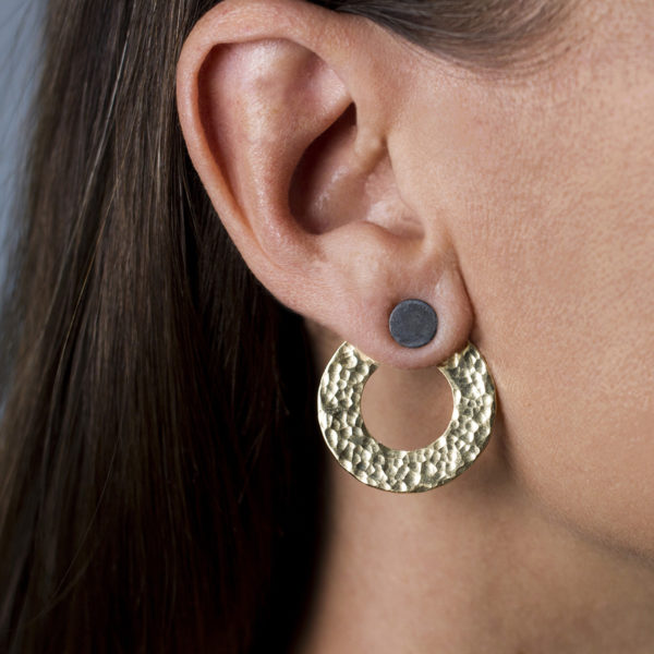 The double earrings have two different carrying options; while the silver stud can also be worn individually - without the brass circle. When worn together - brass circle behind the earlobe, shows up as stylish ear jacket earrings.