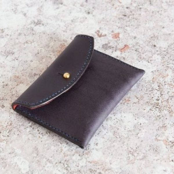Hand stitched Italian leather, indigo coin purse with a red suede lining.